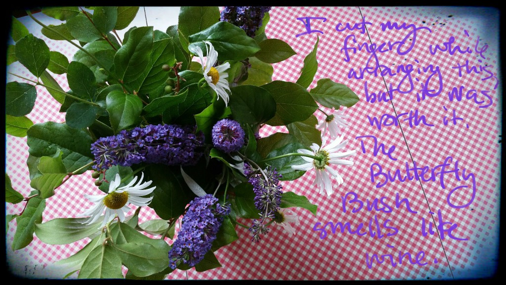 butterfly bush, salal & daisy flower arrangement
