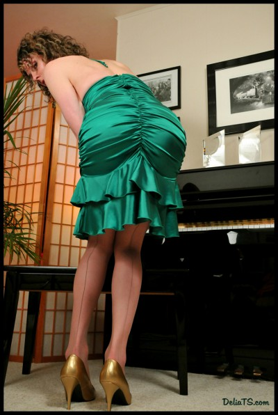 Delia's ass in satin dress and seamed pantyhose.
